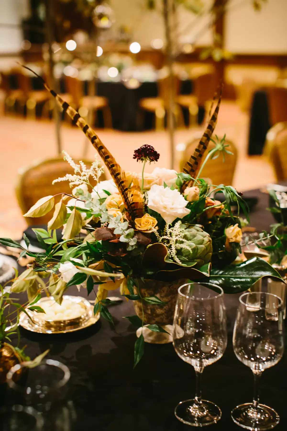 flower centerpieces with feathers