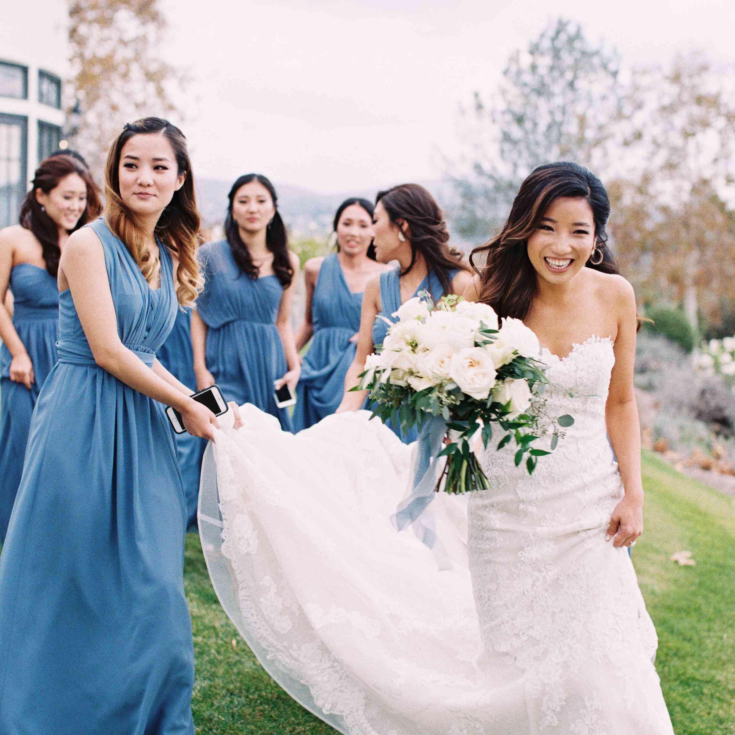 Bridesmaids holding train