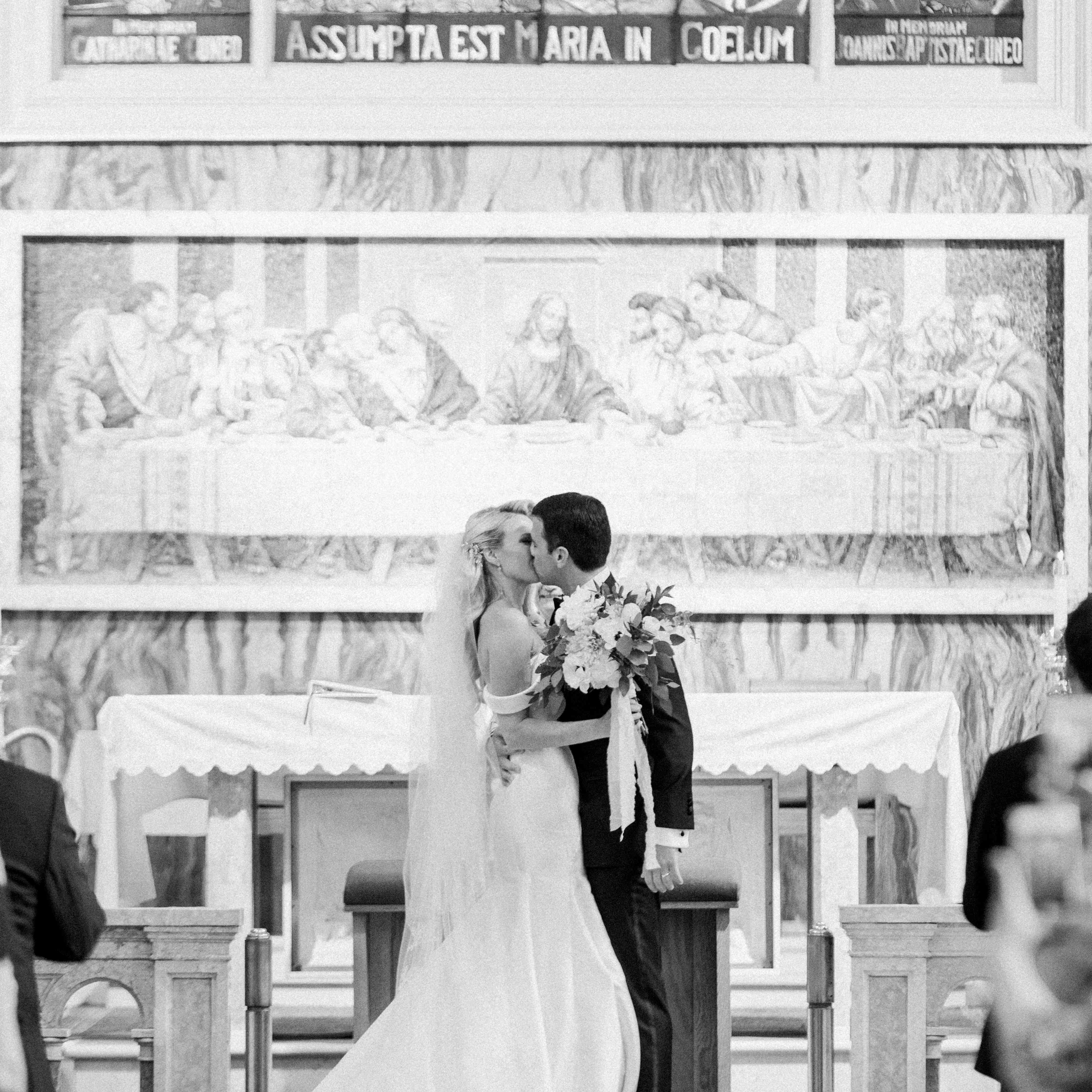 <p>Bride and groom kissing in church</p><br><br>