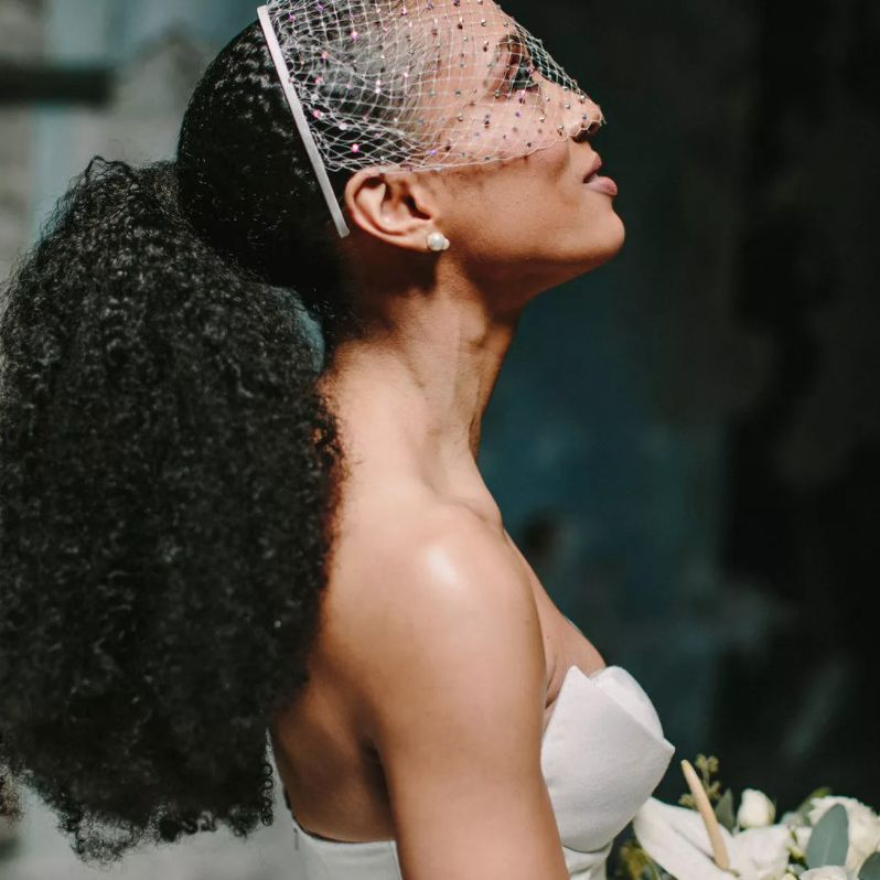 bride with ponytail and veil