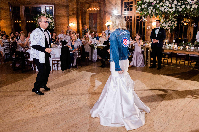 <p>Bride in cubs jacket</p><br><br>