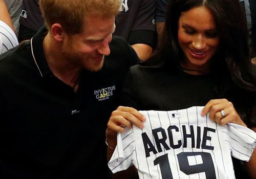 Prince Harry and Megh`an Markle attend a baseball game in support of the Invictus Games Foundation.