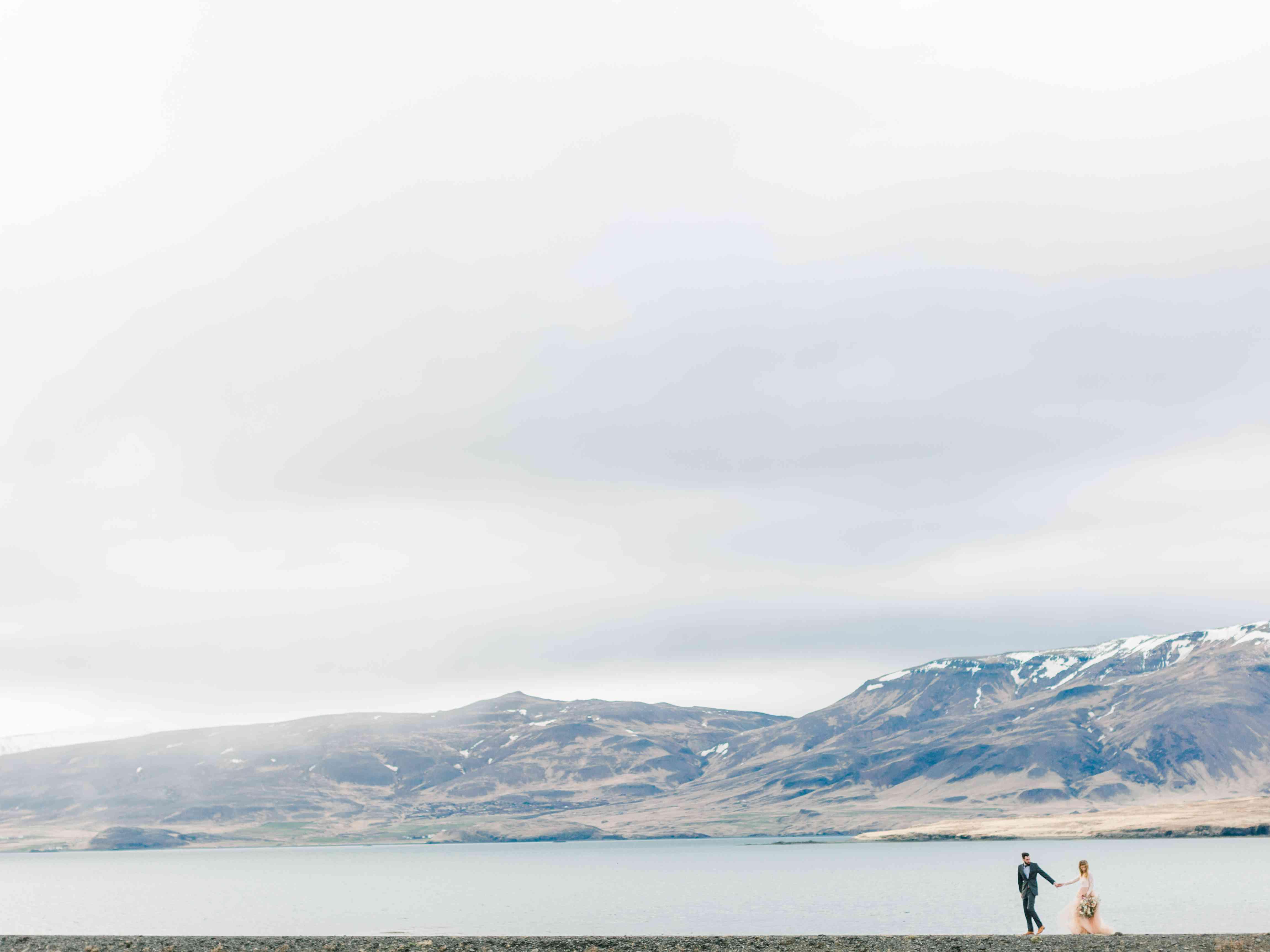 Couple walking in Kjos, Iceland