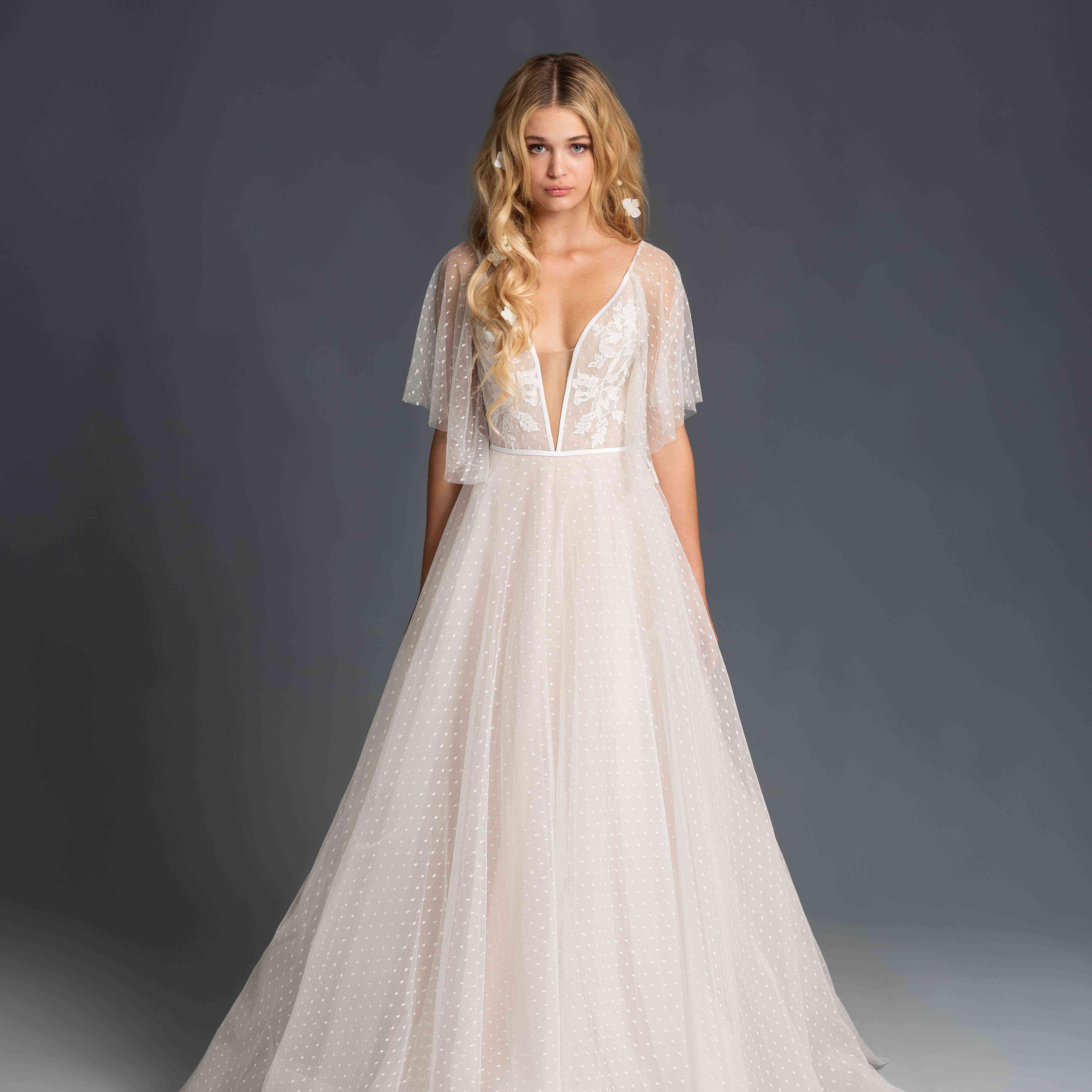 Model in flutter sleeve wedding dress