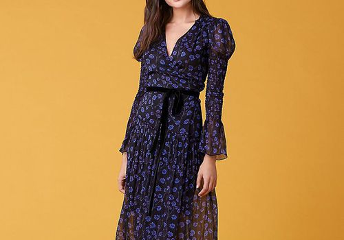 Woman in black and blue floral maxi dress.