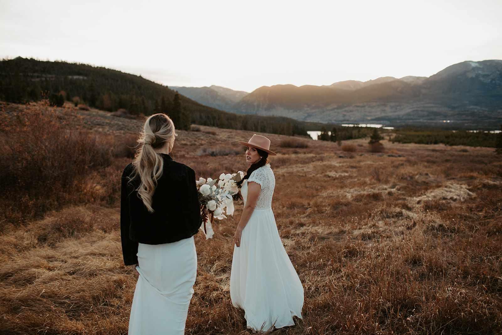 Brides walking in mountainside