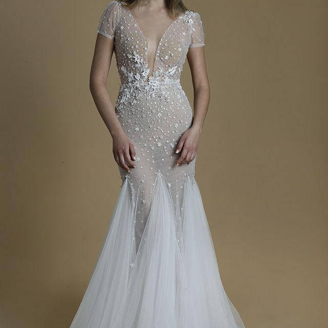 Model in sheer illusion wedding gown