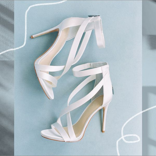 Photo composite of white strappy heels on a blue background.