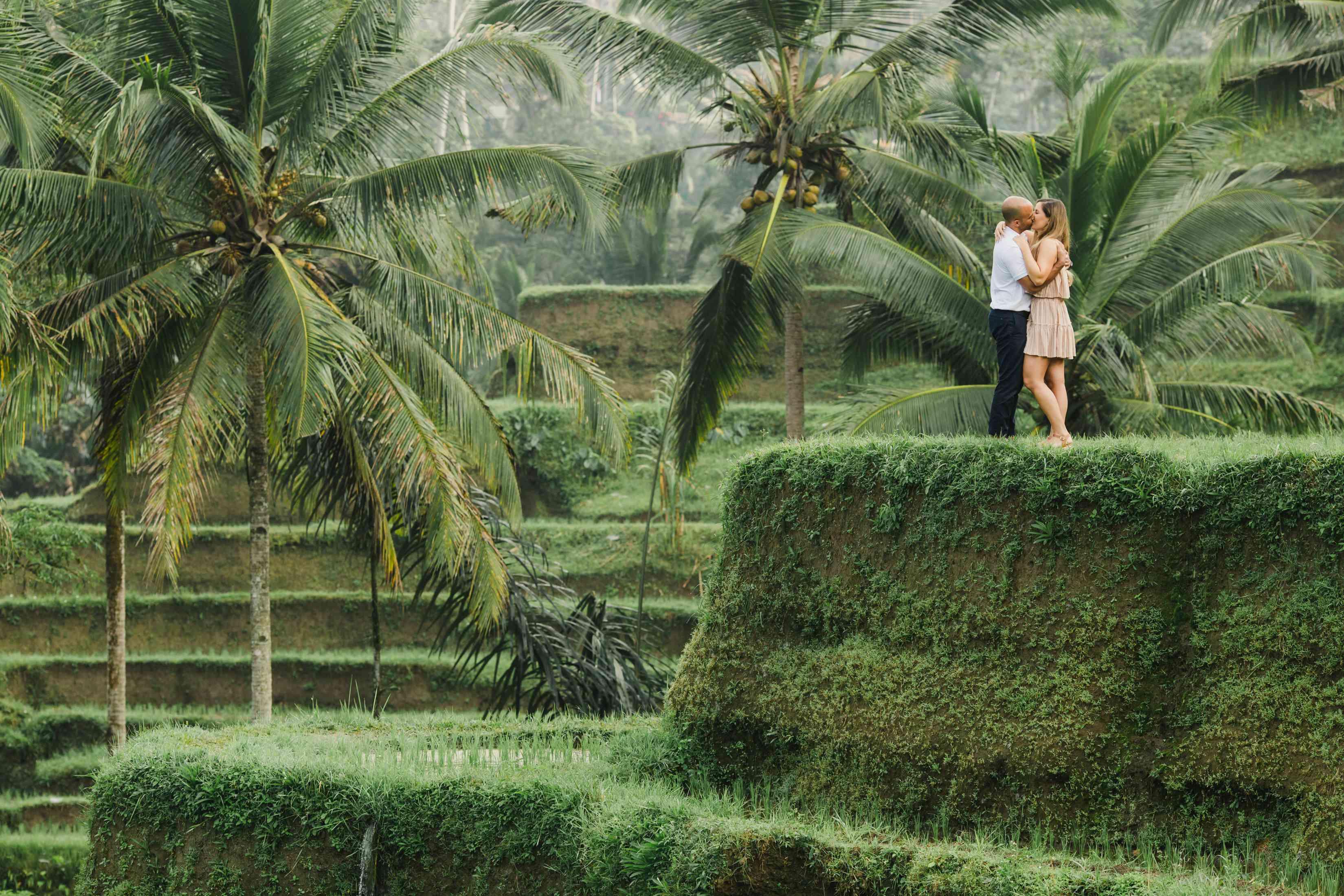 Couple kissing on Bali rice terraces