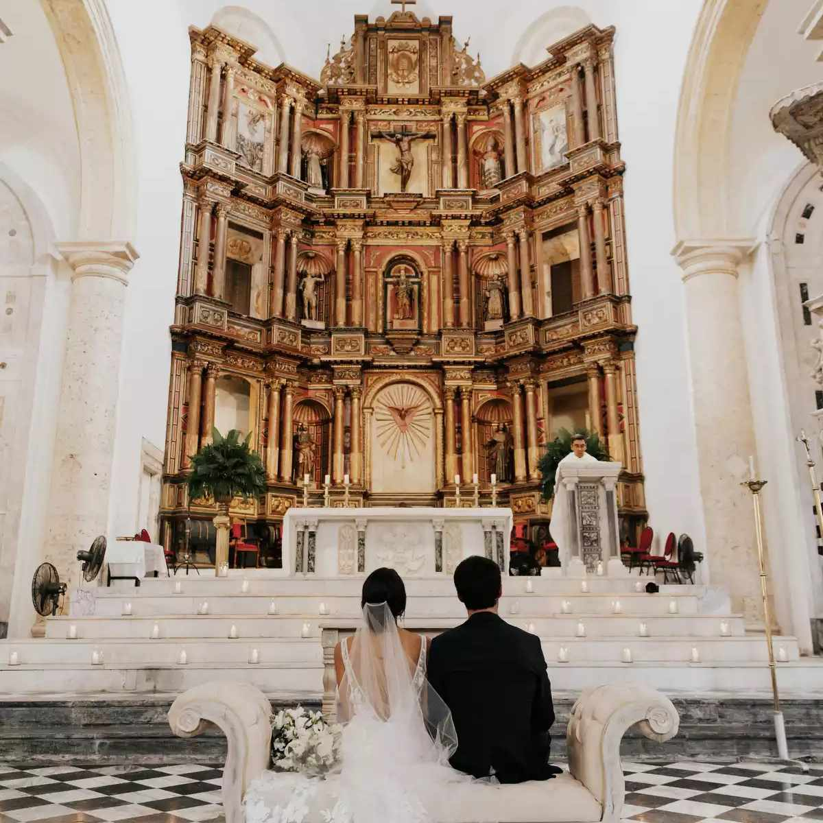 church with couple sitting on bench