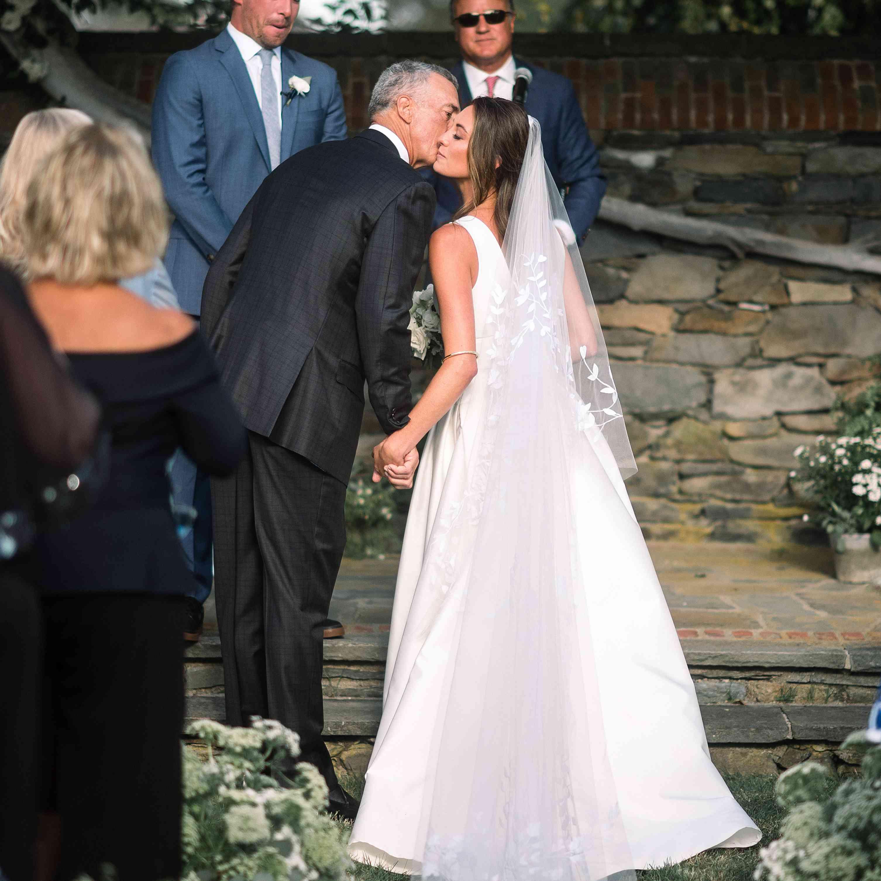 <p>Bride kissing dad</p><br><br>