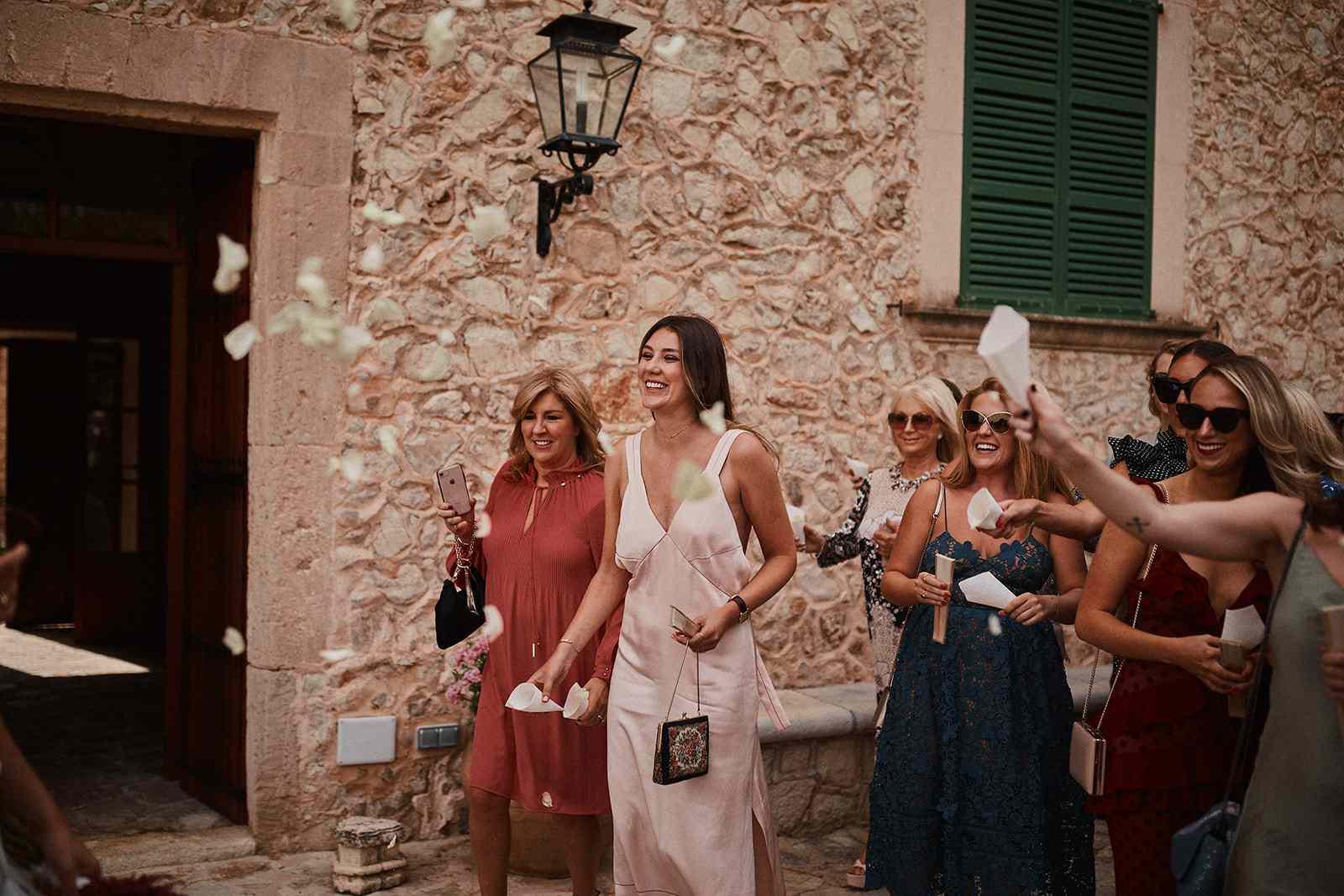 Wedding guests cheering