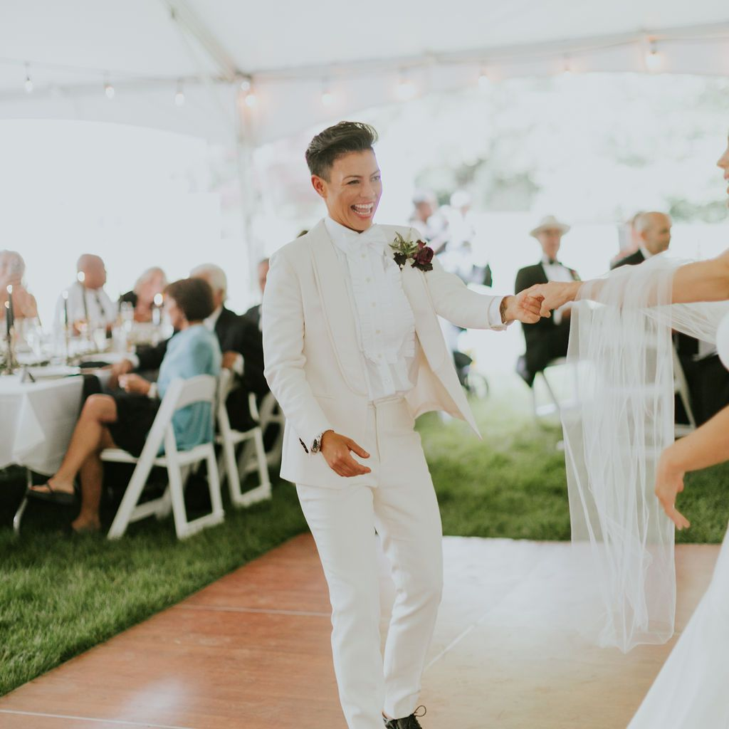 Kiyomi laughs as the couple dances