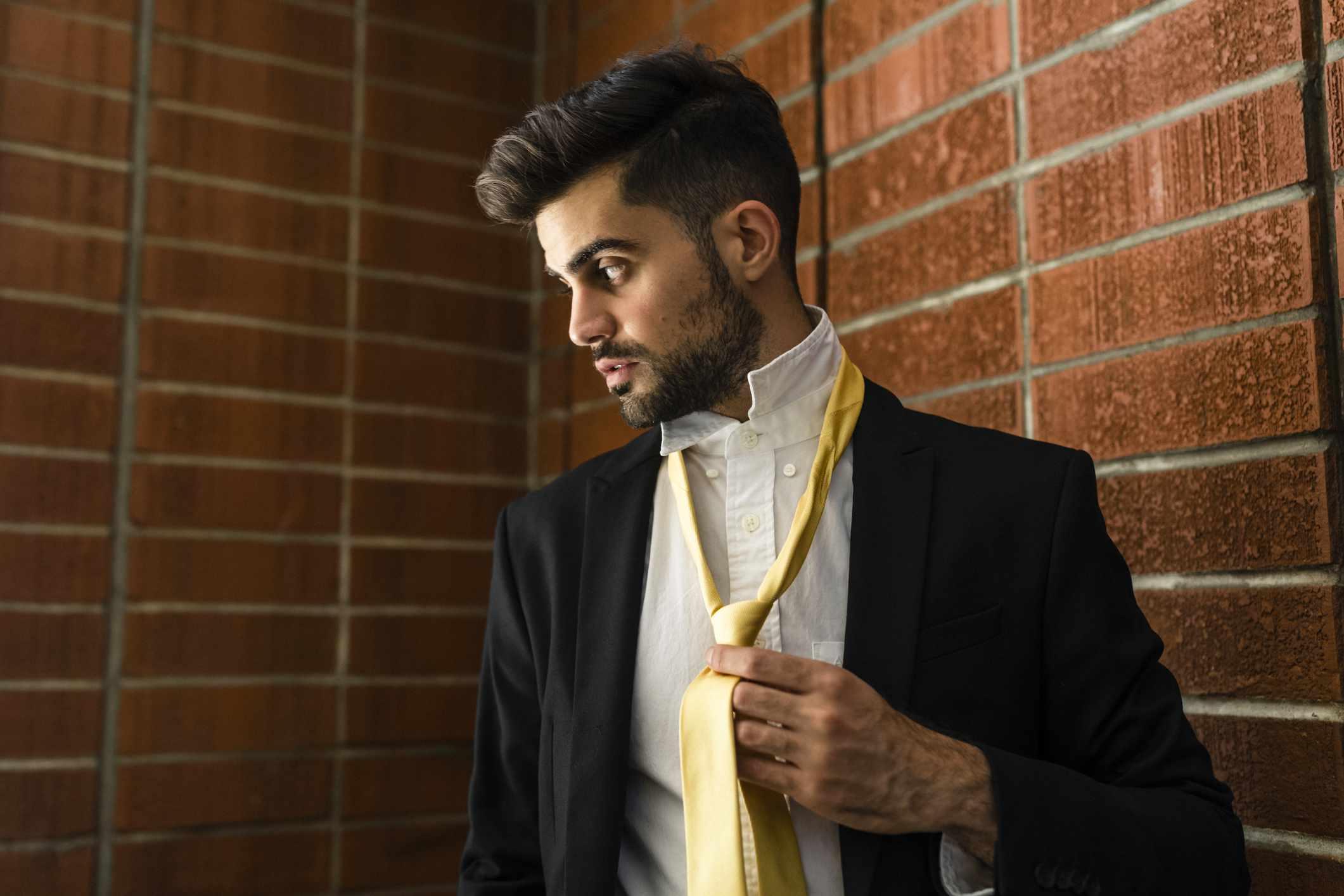 Groom wearing tie