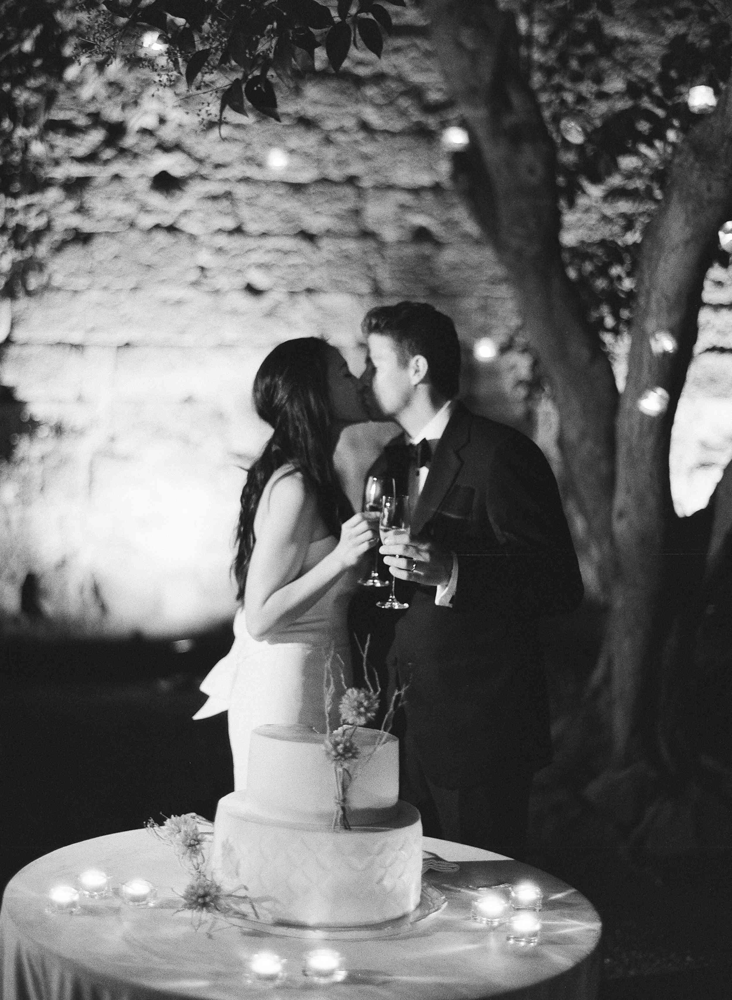 classic la badia italian wedding, bride and groom kissing reception