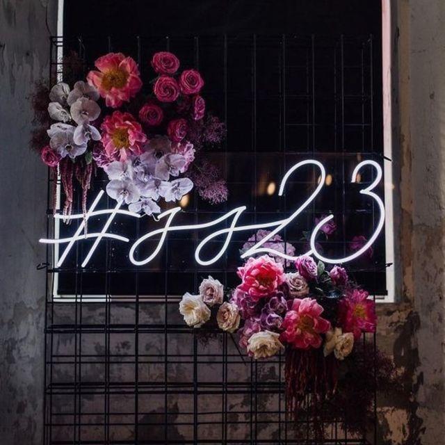 neon wedding hashtag sign