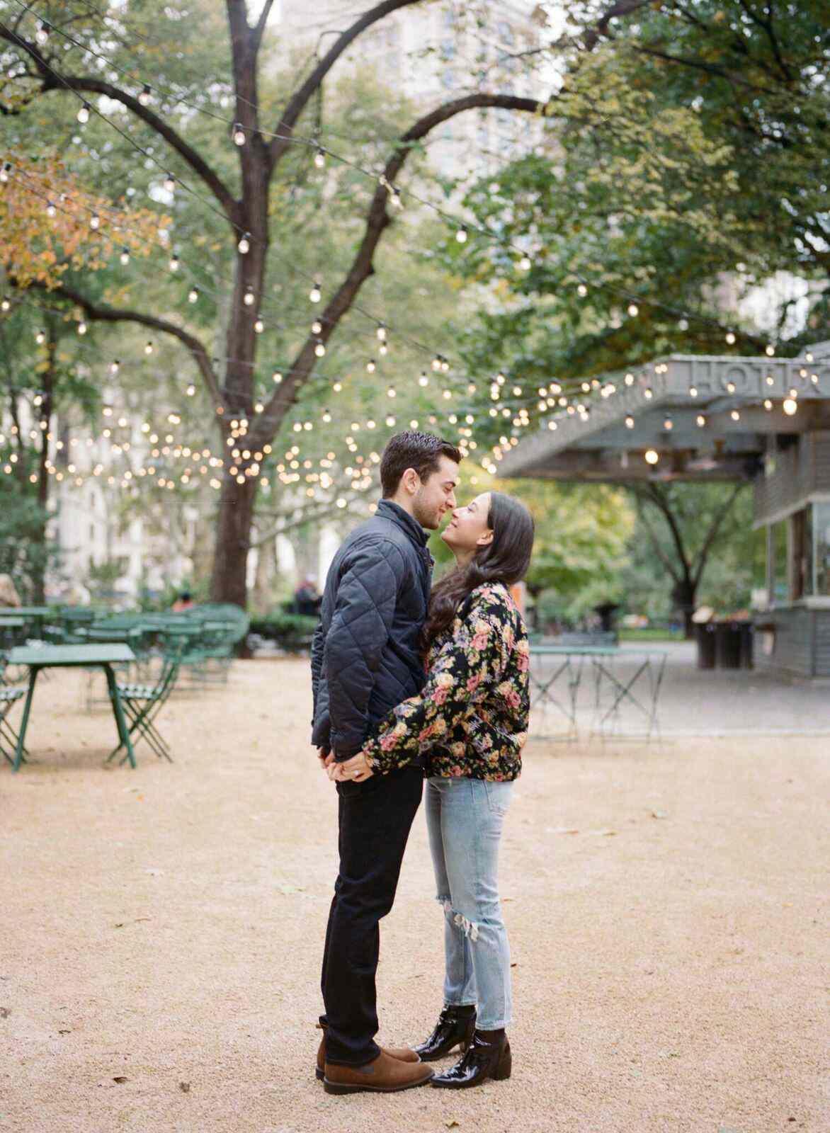 Couple posing in a courtyard