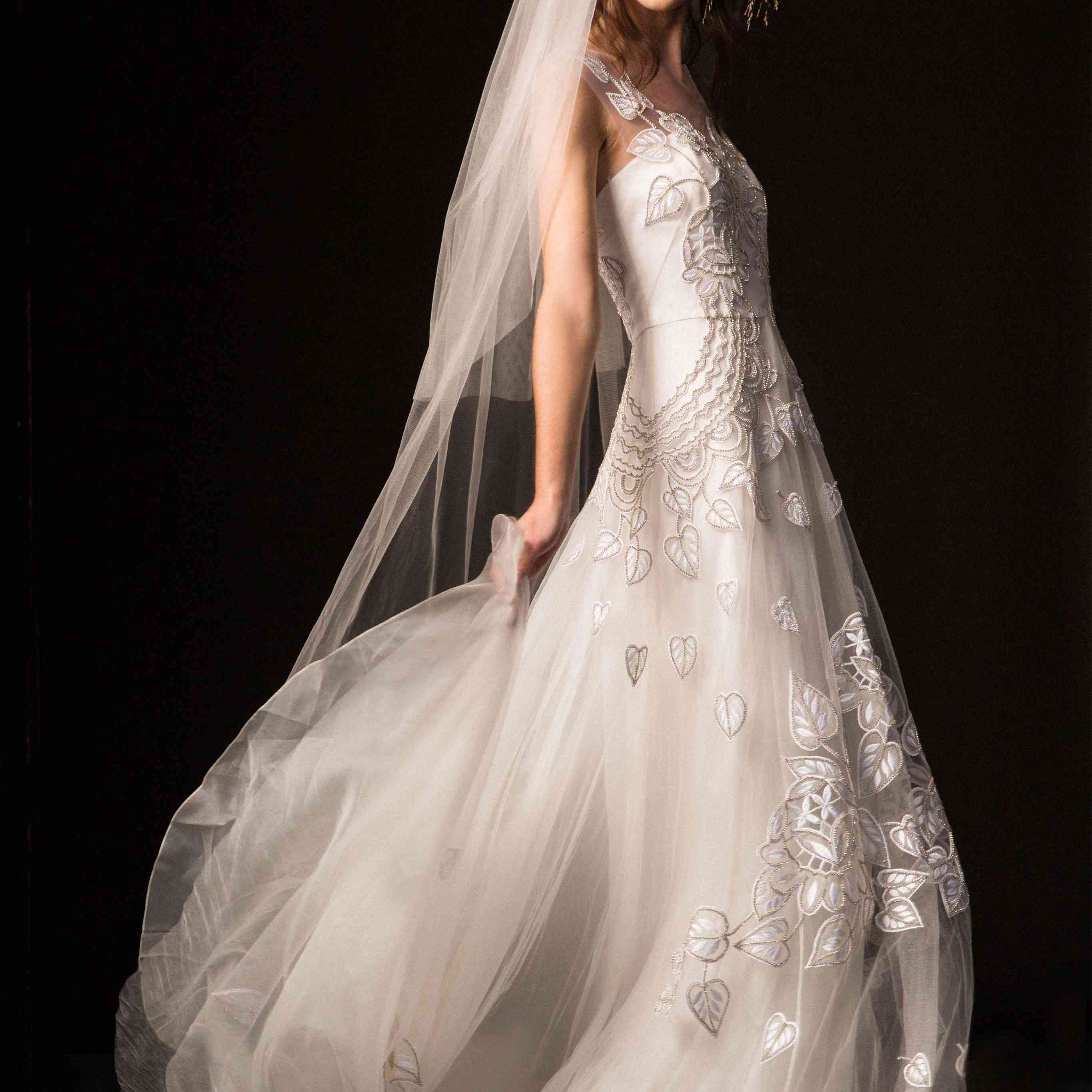 Model in floral embroidered tulle wedding gown