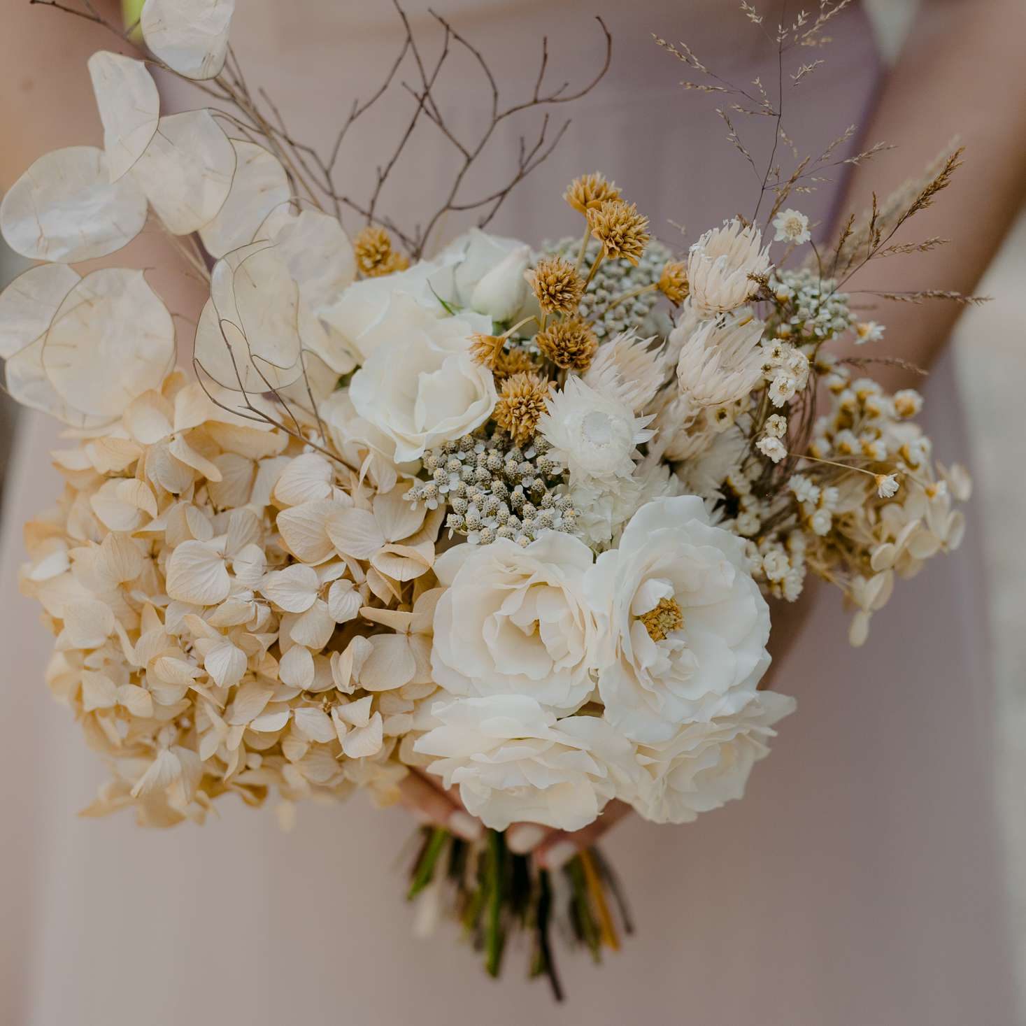 Arrangements of hydrangeas, roses, and dried flowers