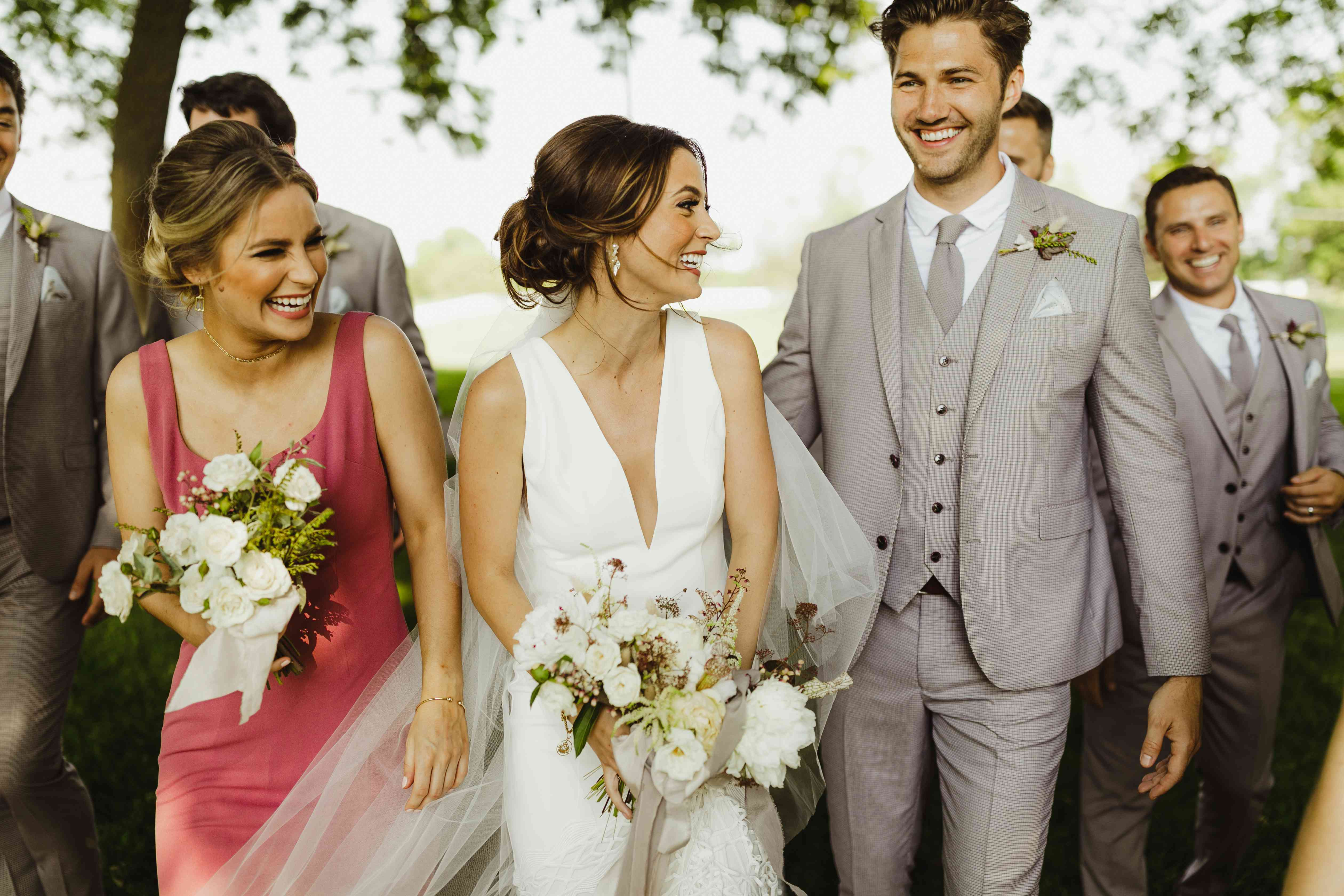 <p>bride and groom with maid of honor</p><br><br>