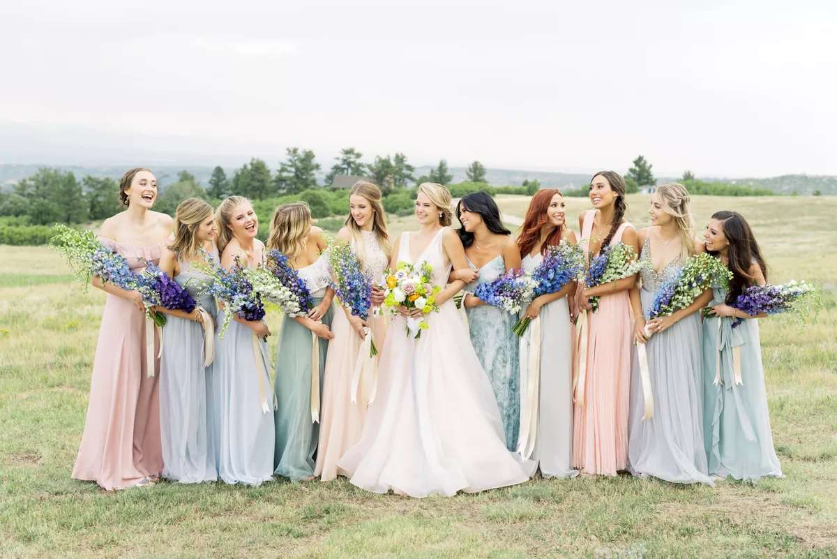 bridesmaids with blue bouquets
