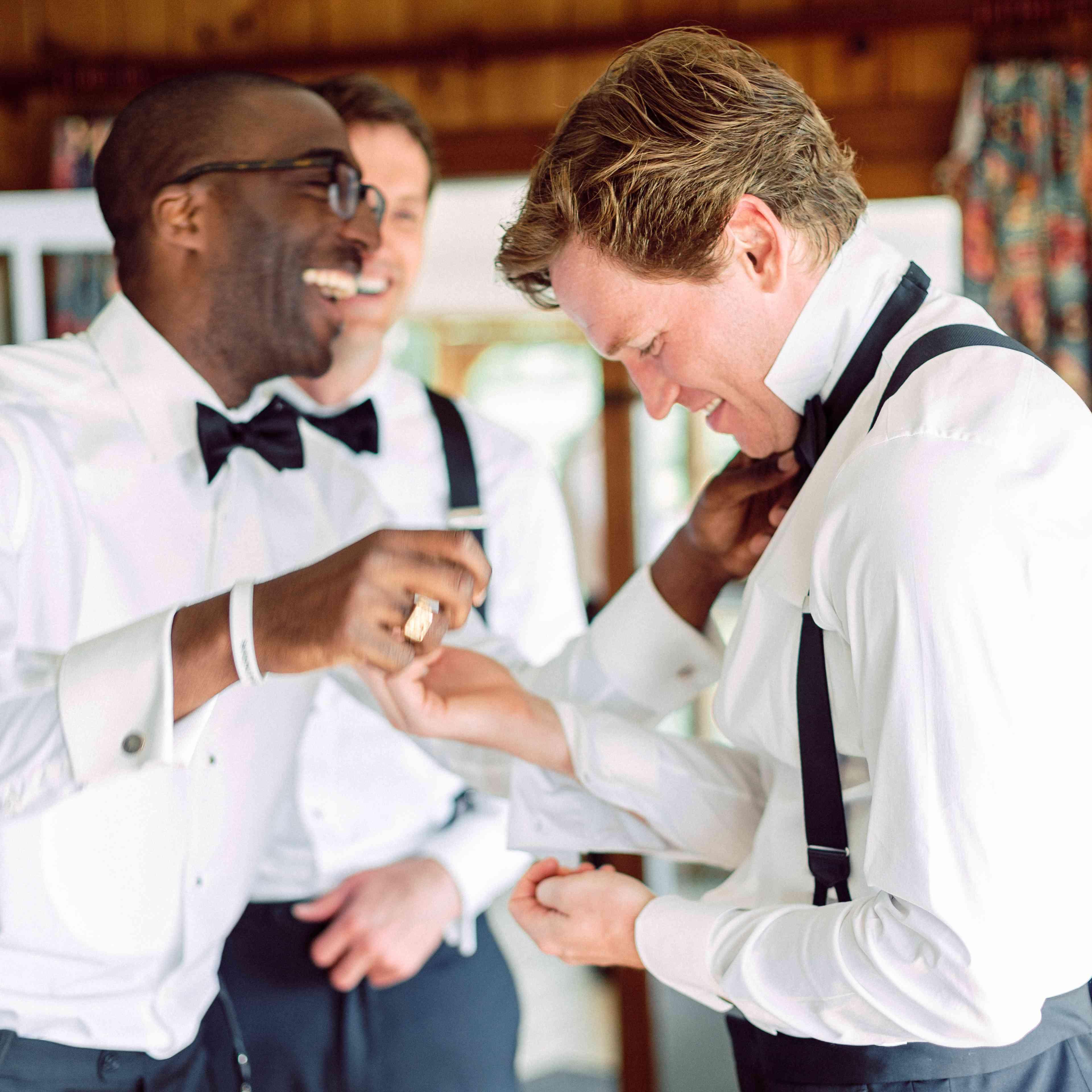 groom and groomsman laughing happy