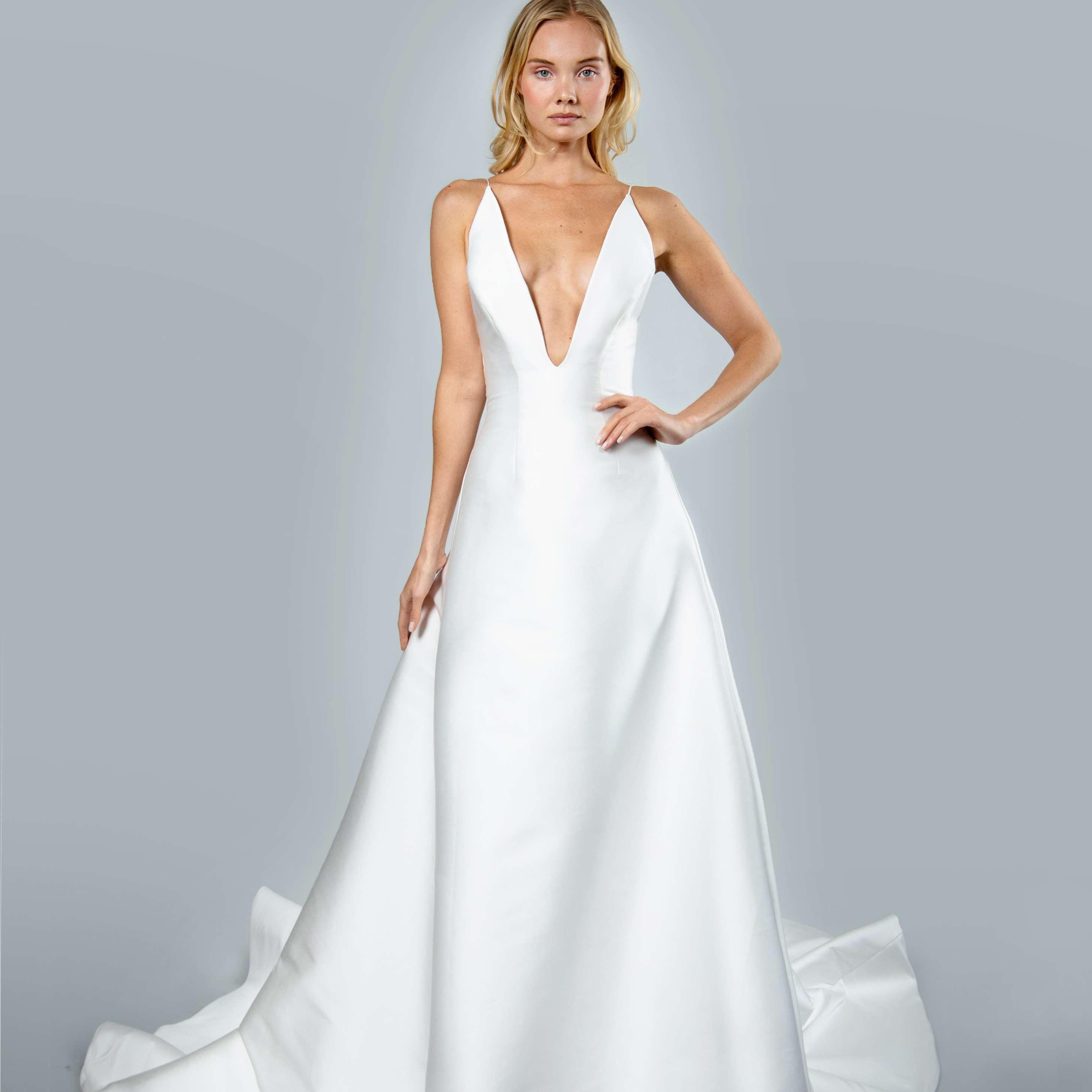 Model in plunging neckline wedding ball gown