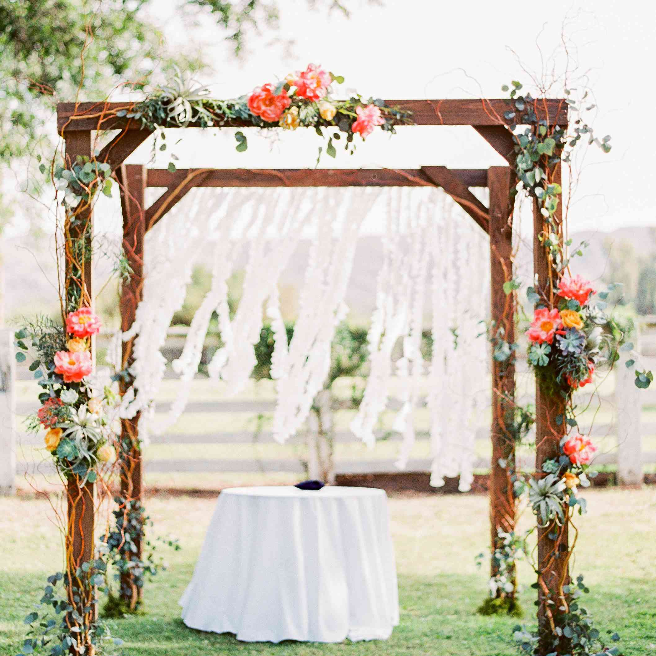 Wooden chuppah with bright florals