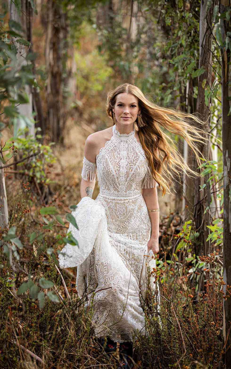 Model in lace fringe wedding gown