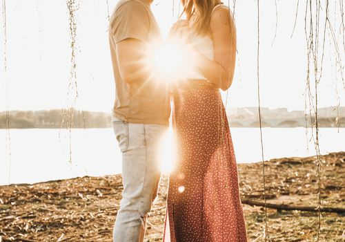 couple hugging with sunlight behind them