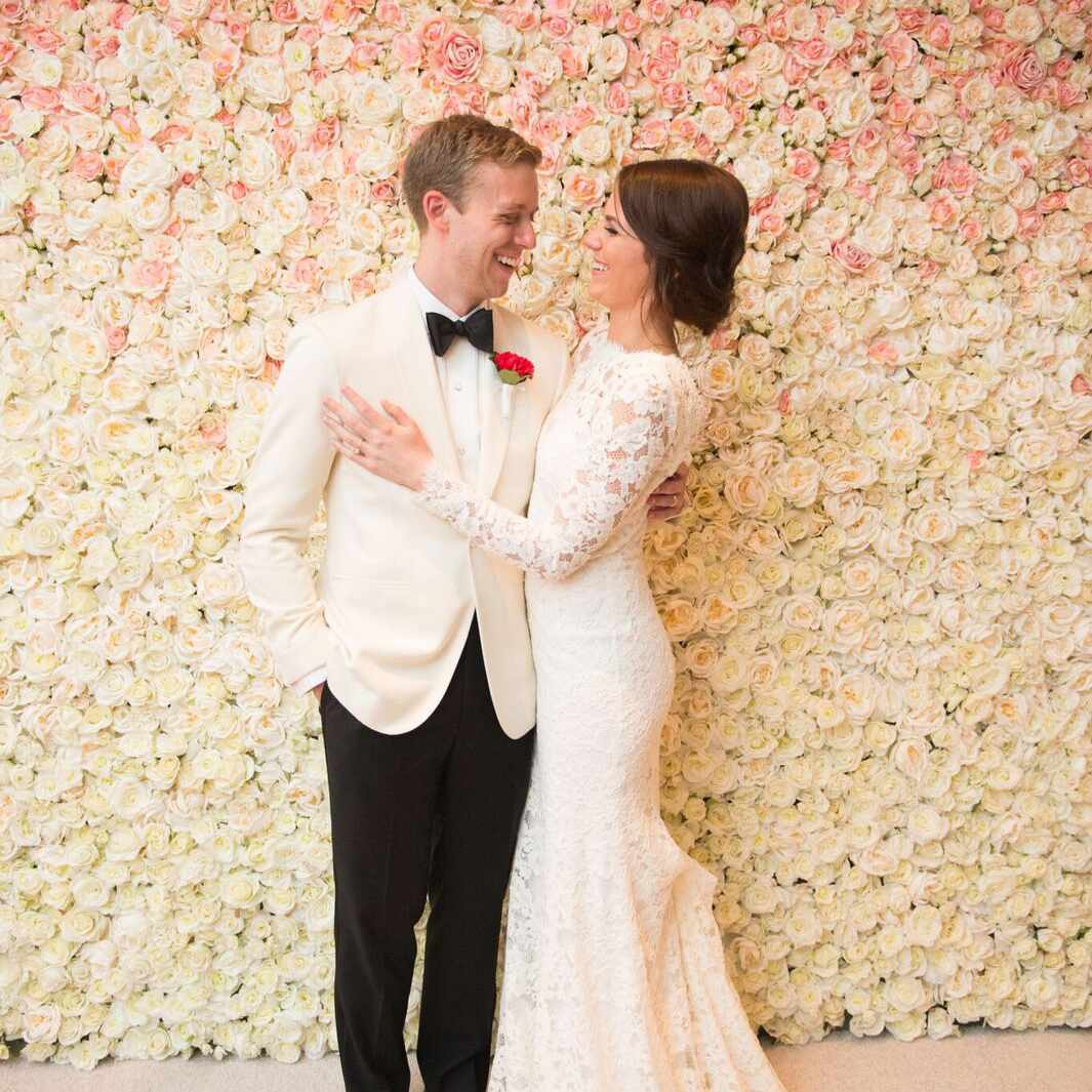 Floral wall gradient with bride and groom
