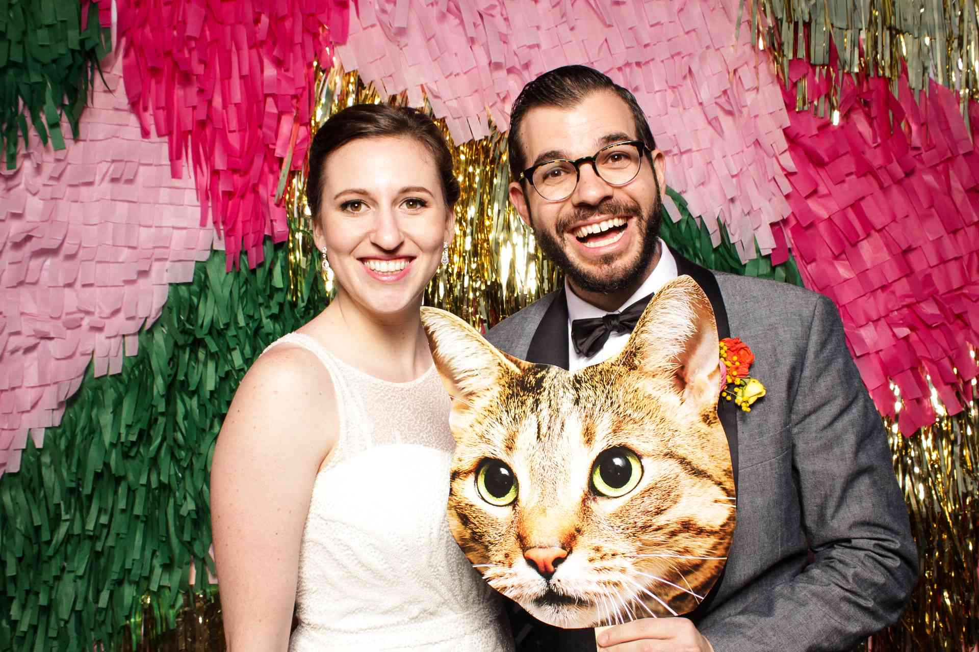 Couple with cat prop in photobooth