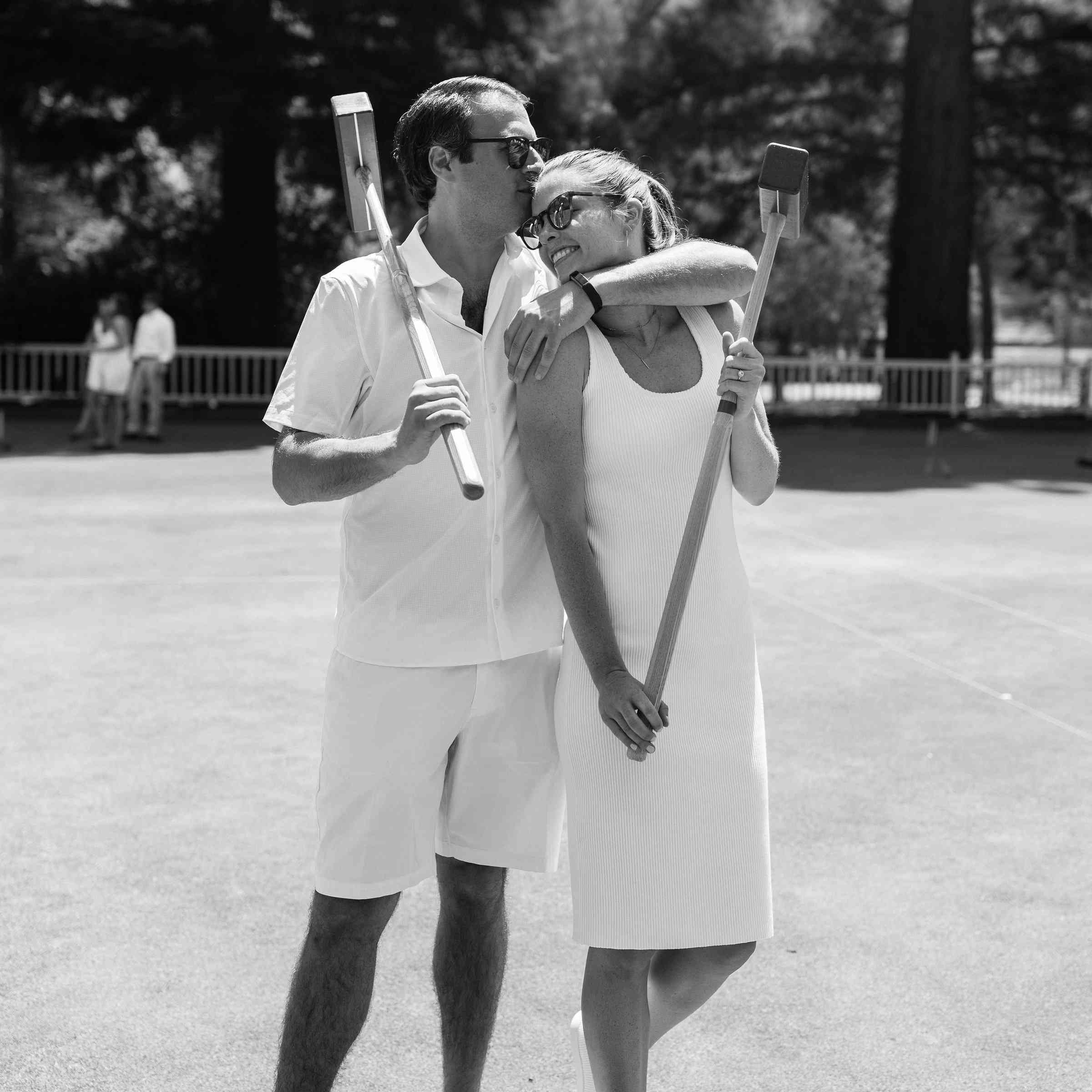 bride and groom playing croquet