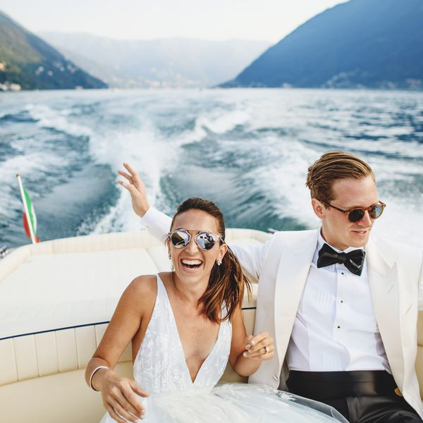 bride and groom riding on boat