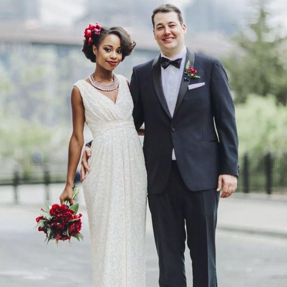 Newlyweds portrait in front of bridge