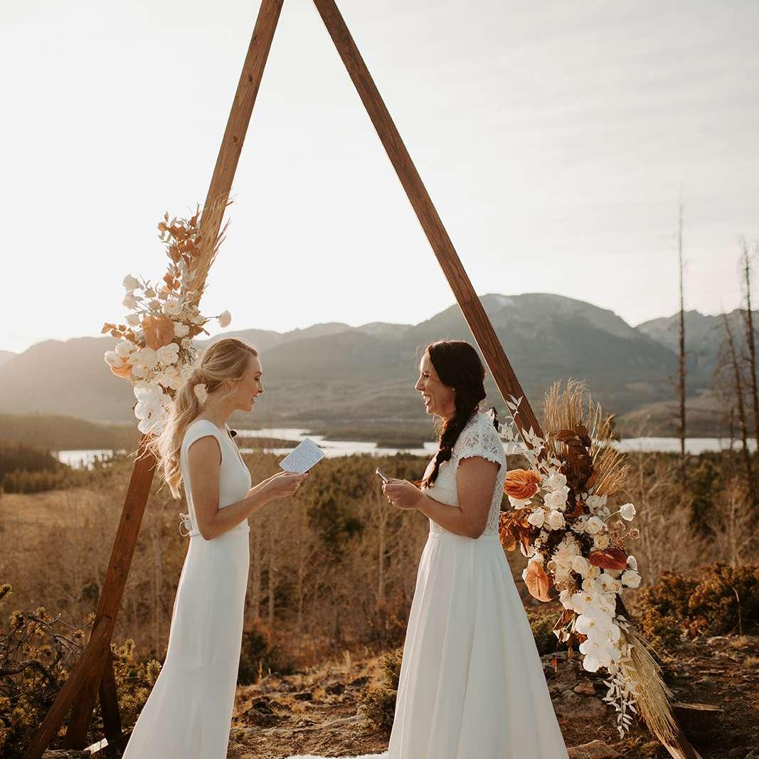 Brides reading vows at altar