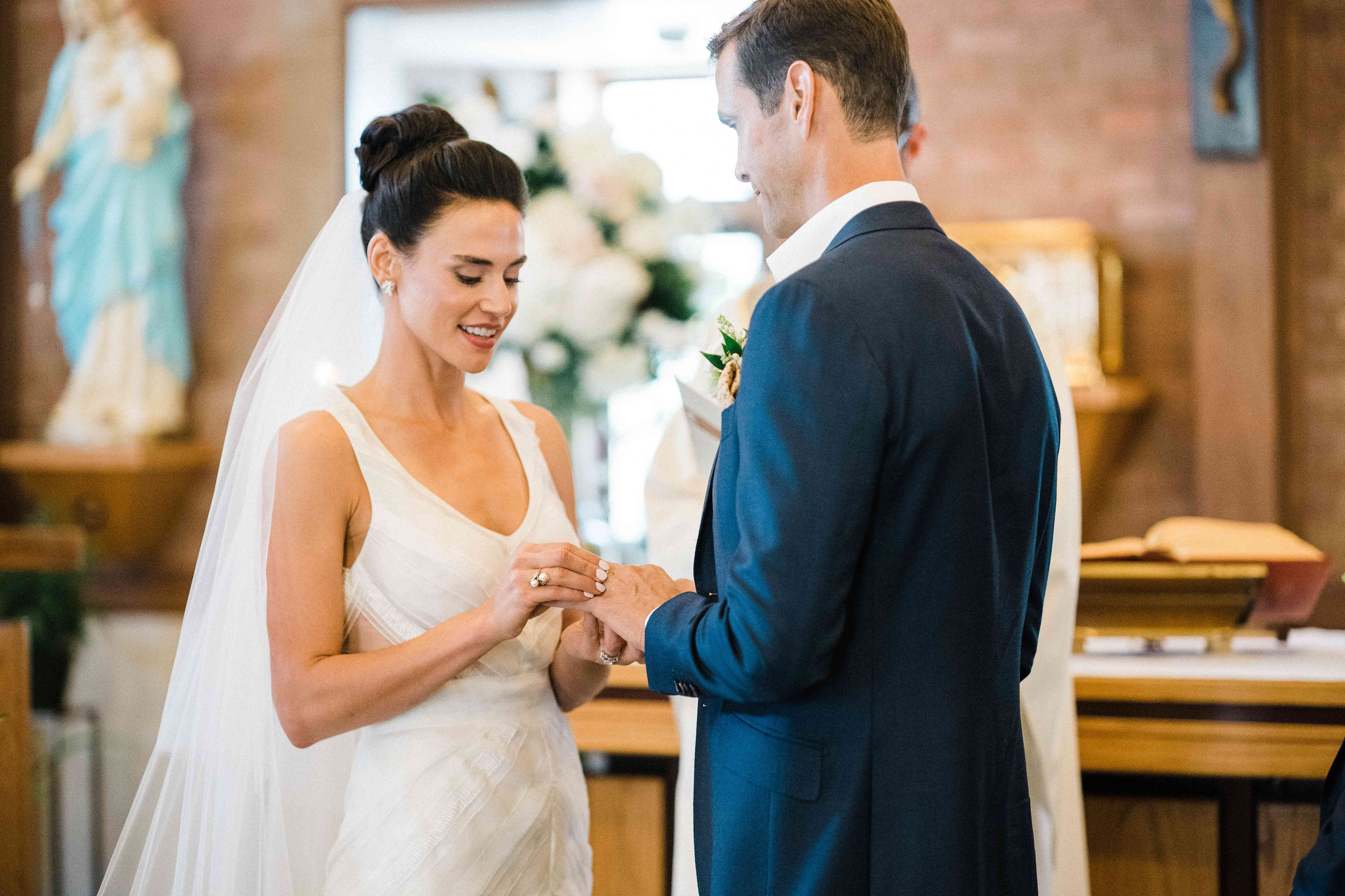 <p>Bride and groom exchanging rings</p><br><br>
