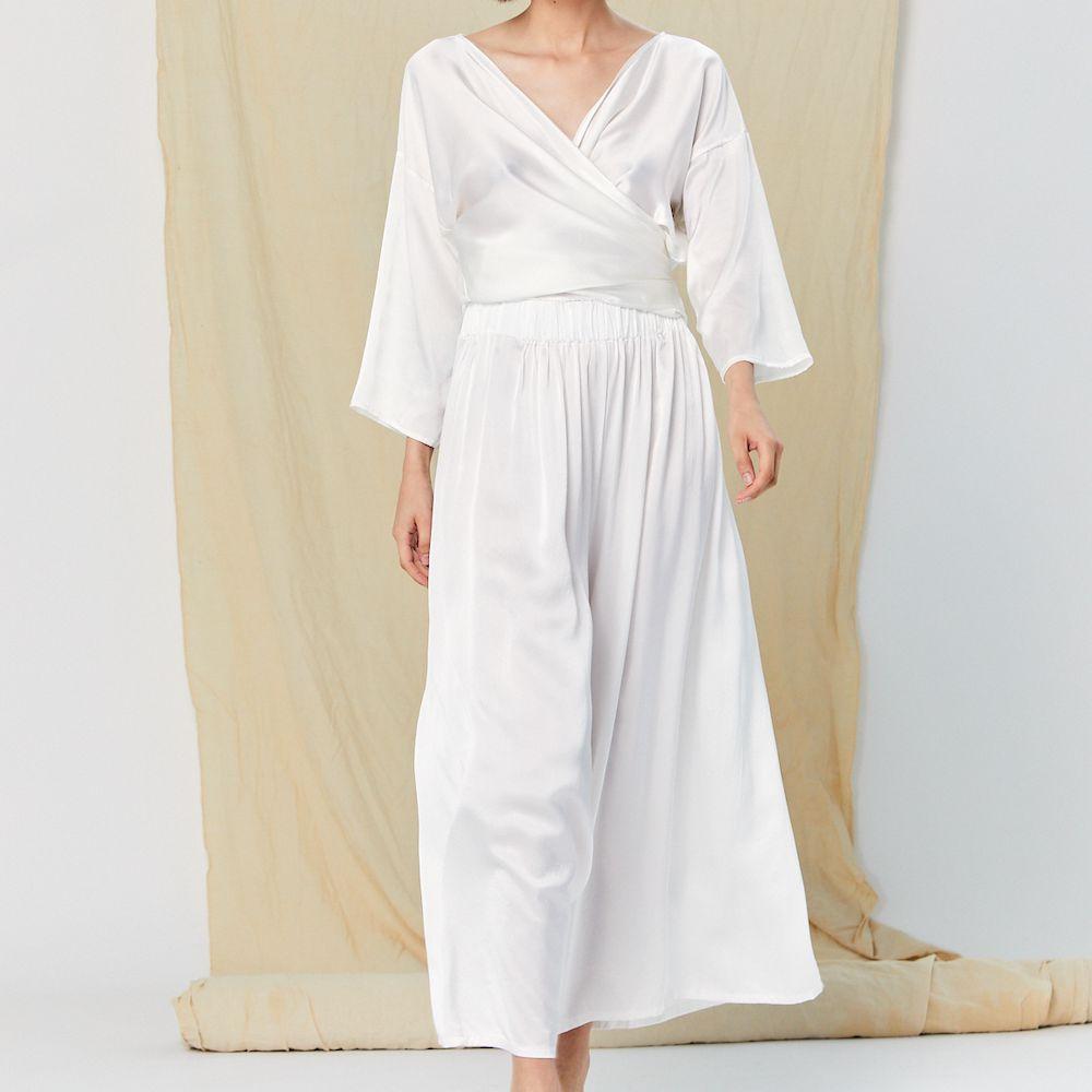 Model wearing Miranda Bennett wedding separates white silk wrap top with white silk palazzo pants