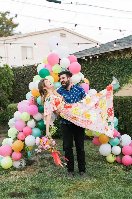 Multi-colored balloon backdrop shaped like an upside down-shaped v