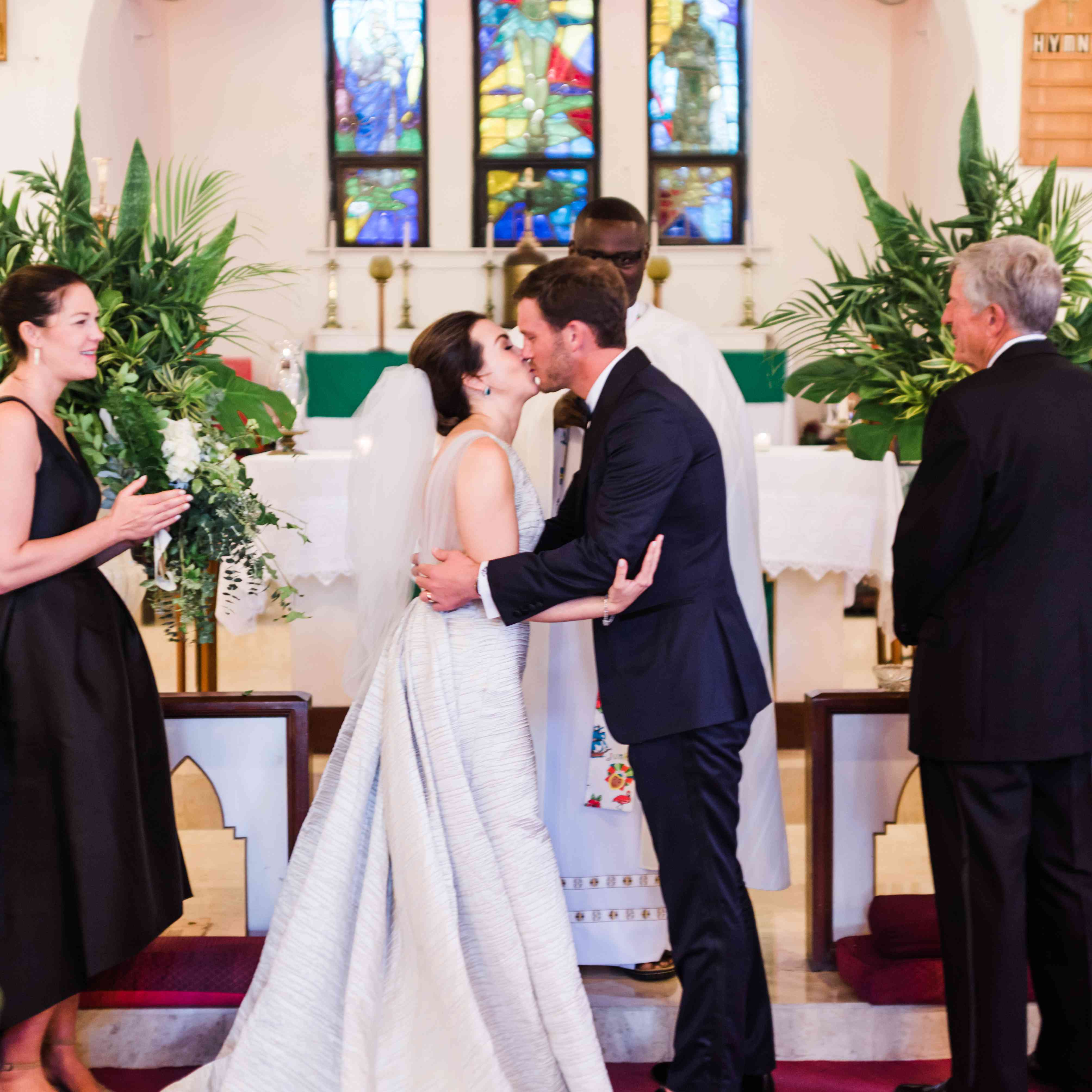 <p>bride and groom kissing altar</p><br><br>