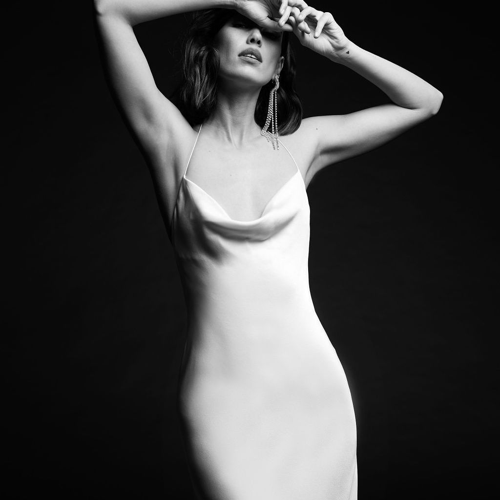 Model in fitted crepe dress with scoop neck and spaghetti straps
