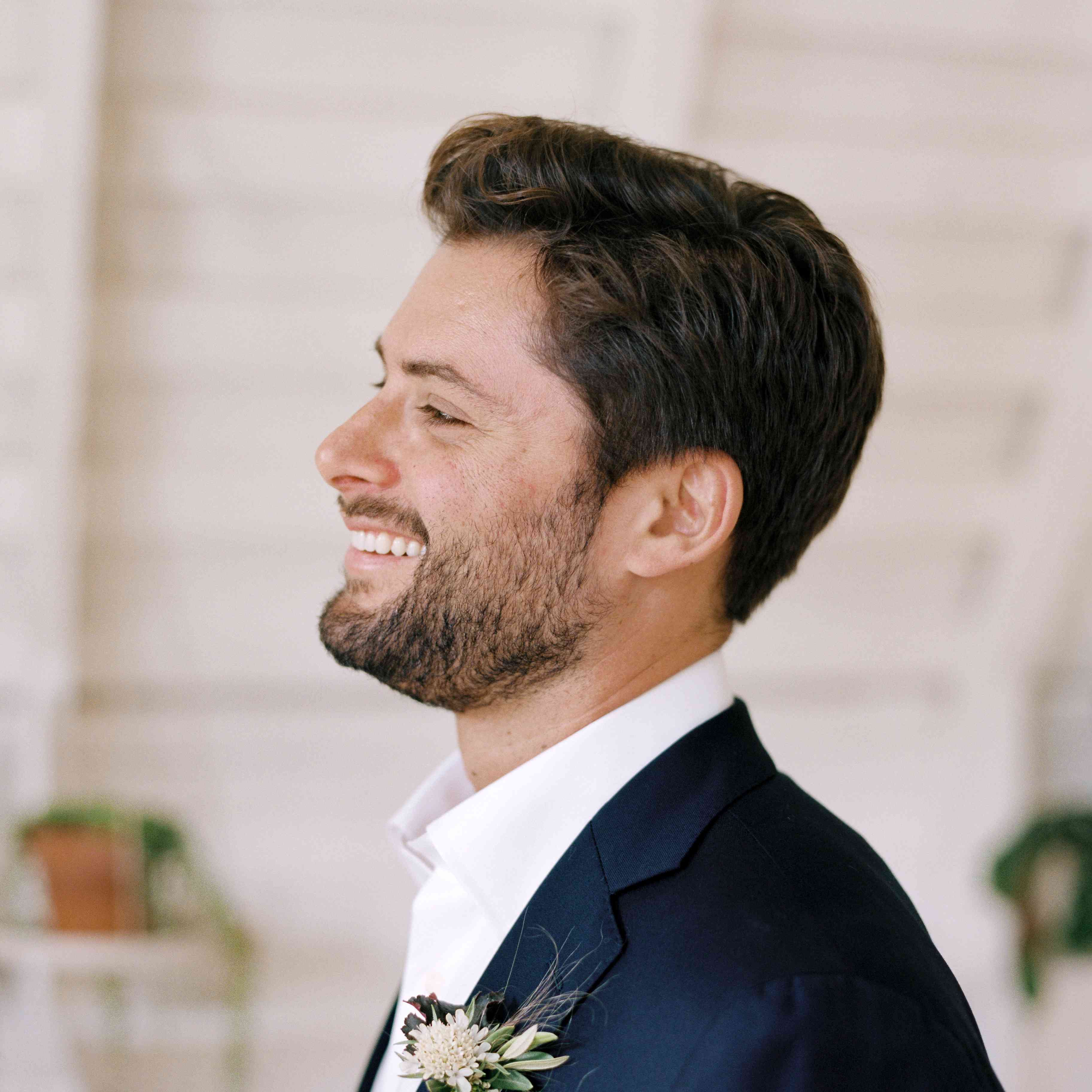groom with beard and boutonniere