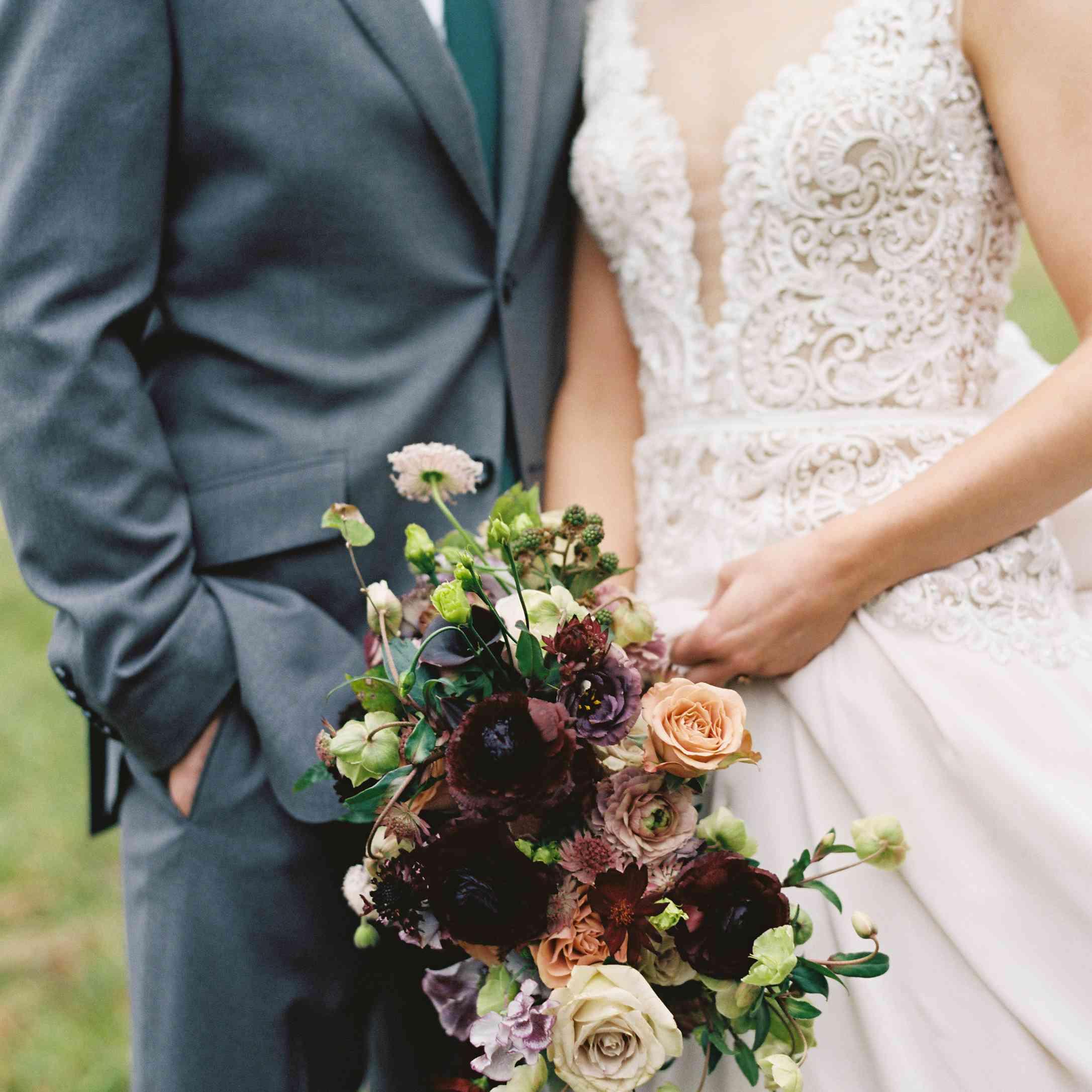 bride and groom moody winter florals