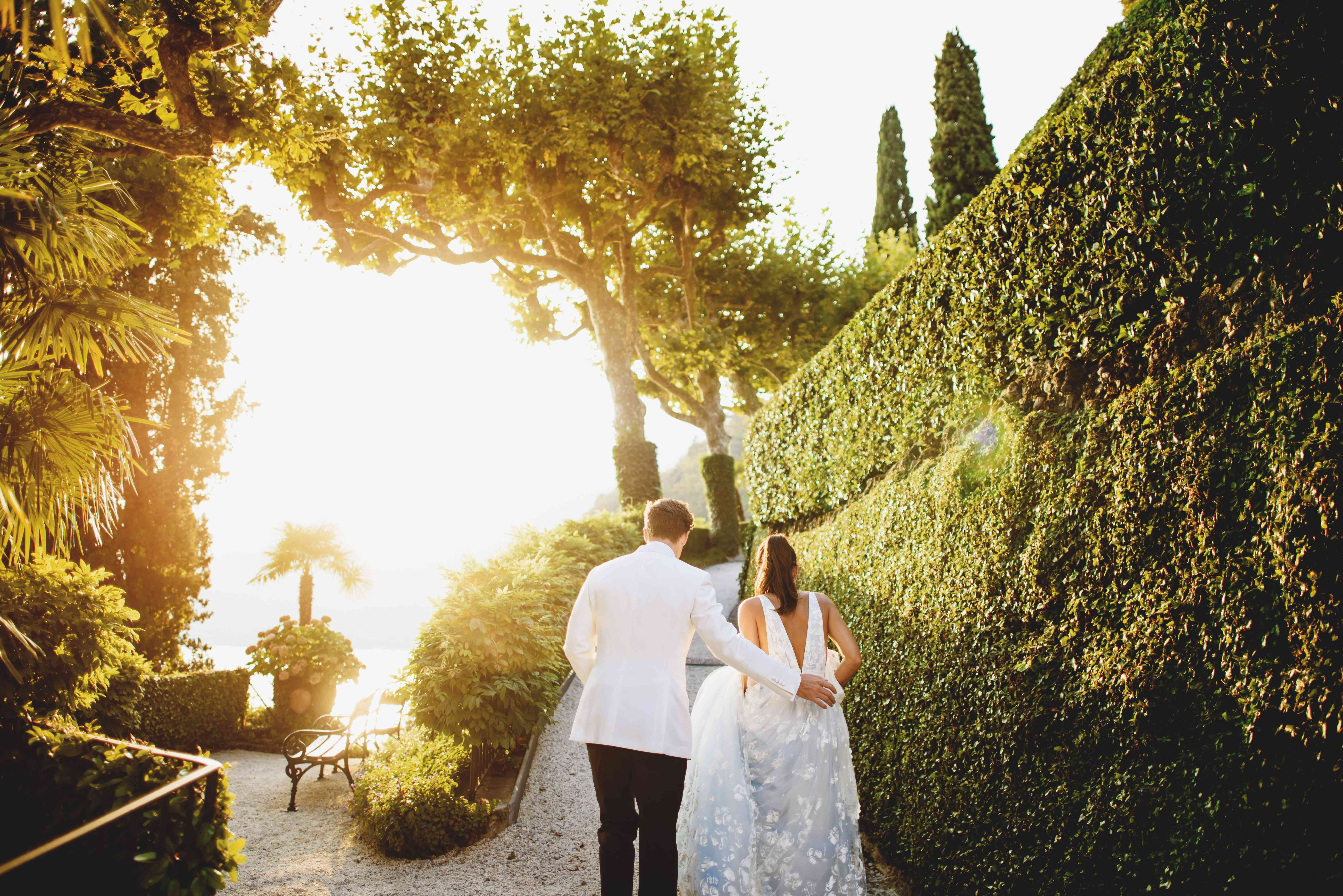 bride and groom in garden at sunset
