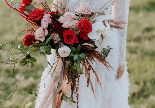Red and burgundy wrapped wedding bouquet