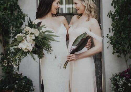 Two girls from the bridal party wearing dresses