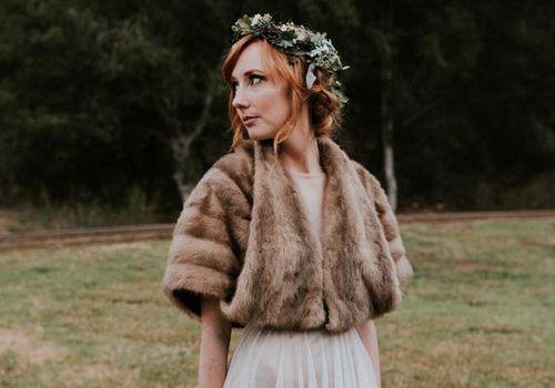 Winter bride wearing a fur wrap
