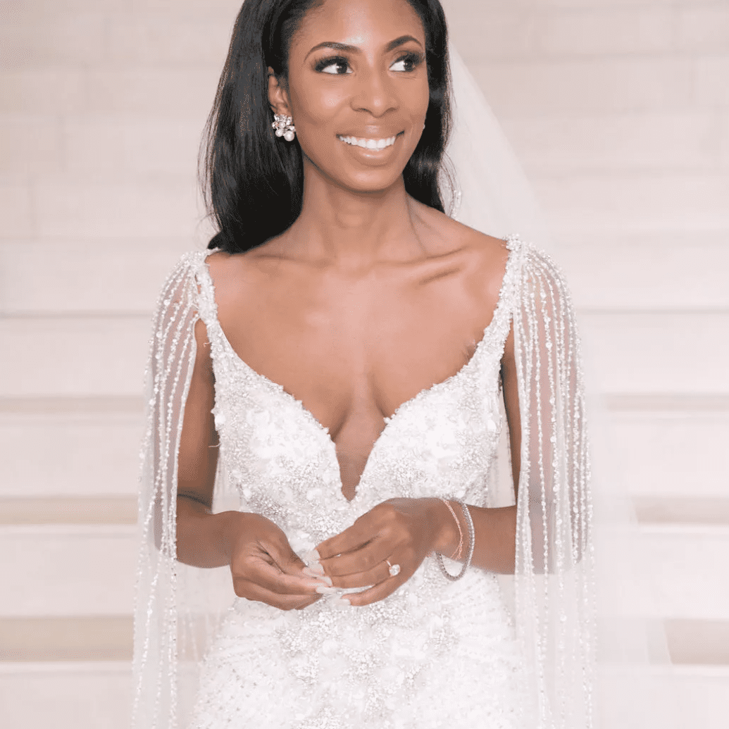 Bride with soft makeup and embellished cape