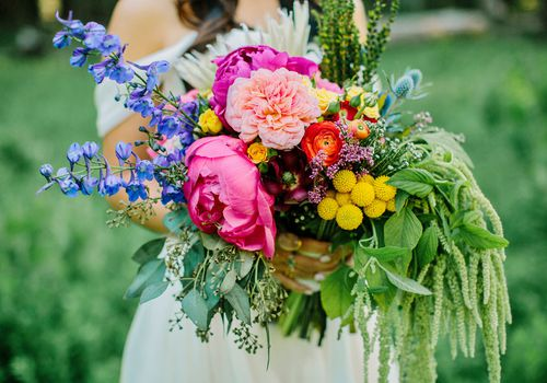 A bride holding an extravagant flower bouquet
