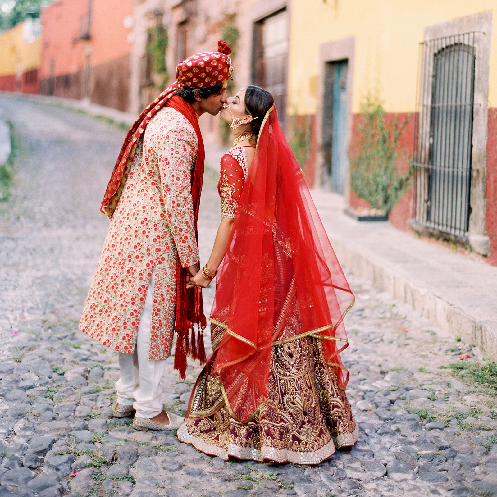 https://www.brides.com/thmb/Uv196ZPnn1jRs8sm-cWDmRVjbaY=/1600x1600/filters:fill(auto,1)/dulce-and-nashant-wedding_01-5e6e0ffe06b242a7ab3714c4b494d550.jpg
